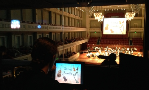 Kelley runs the powerpoint projection from the Schermerhorn light booth, March 3, 2015
