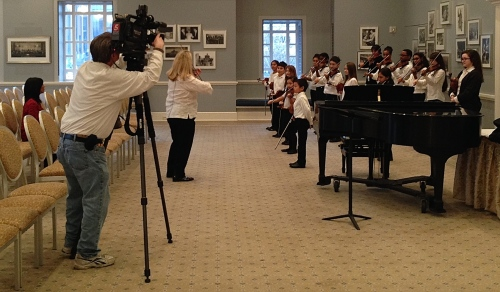 NewsChannel 5's Charlie Woodward films students in the Nashville Symphony Suzuki Program as they warm up for a performance with the orchestra, March 4, 2015