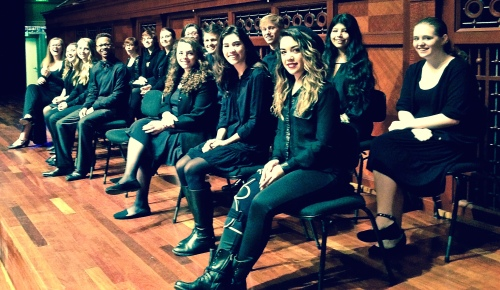 NSA Madrigal Singers on the stage of Laura Turner Hall before a performance of Amahl and the Night Visitors, December 6, 2014
