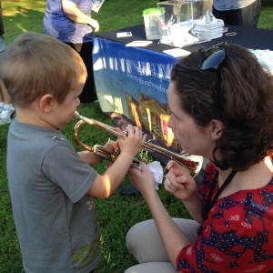 from my Instagram feed: Nashville Symphony Education & Community Engagement Program Manager Kelley Bell guides a young guest in playing his first notes on the trumpet at our Community Engagement Concert at Centennial Park, Nashville, June 4, 2015