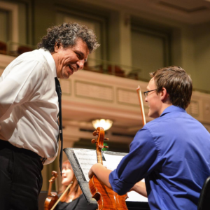 Music Director Giancarlo Guerrero works with a student during Side-by-Concert rehearsals, May 20, 2015