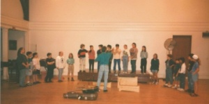 preparing young singers for a performance, Blue Rock School, 1994