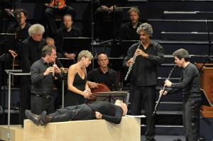 Soprano Camilla Tilling and Mark Padmore as the Evangelist with Sir Simon Rattle and the Berliner Philharmoniker in Peter Sellars's staging of Bach's St Matthew Passion at the BBC Proms 2014. Photo Credit: BBC/Chris Christodoulou