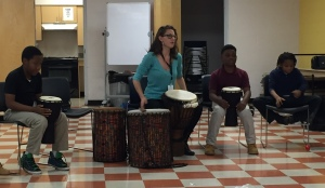 Nashville Symphony Education & Community Engagement Assistant Kristen Freeman leads a drum circle activity at our NAZA program at Hartman Park Community Center, Nashville