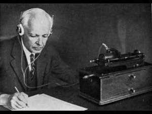 Béla Bartók notating music he collected in the field