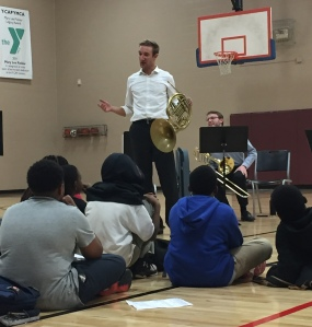 Nashville Symphony Horn Patrick Walle lays it down for students in the YMCA SMARTKids NAZA program while Principal Trombone Paul Jenkins looks on
