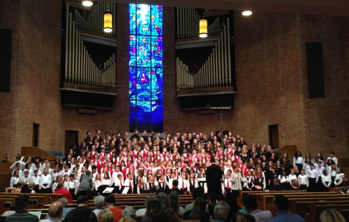 "James Wells leads the combined choirs of the Nashville Children's Choir Program + Alumni, as Madeline Bridges leads the audience in ""Sol-Fa Calypso"" at Homecoming 2016, April 30, 2016, First Baptist Church, Nashville"