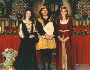 with singers at a madrigal dinner, University of South Florida, 1996